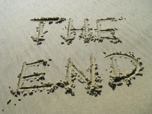 the words 'The End' written in sand